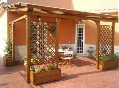 Grigliati in legno grigliati e frangivento da giardino for Grigliati terrazzo